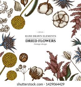 Floral design with colored astilbe, craspedia, blue eryngo, lagurus, cotton, gypsophila