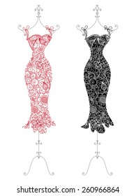 Floral dresses on a stand. Red and black dresses with linear floral elements and patterns.