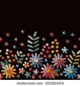 Floral embroidery. Seamless embroidered border with flowers, leaves and berries on black background. Vector illustration.