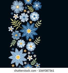 Floral embroidery. Vertical seamless line with beautiful blue flowers on black background. Template for greeting and invitations cards with place for text. Fashion design. Vector illustration.