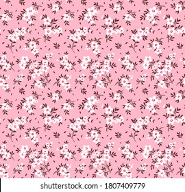 Floral pattern. Pretty flowers on light pink background. Printing with small white flowers. Ditsy print. Seamless vector texture. Spring bouquet.