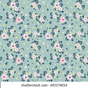 Floral pattern. Pretty flowers on light blue background. Printing with small pink flowers. Ditsy print. Seamless vector texture. Spring bouquet.