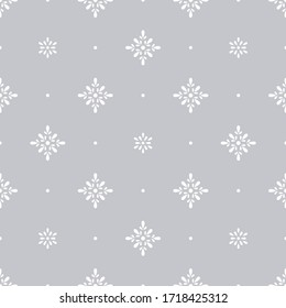 Floral polka dot geometric seamless pattern. White simple vector flowers on gray background. Simple vector geometric illustration. Polka dot abstract design for printing on textile, fabric, paper