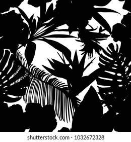 Floral seamless pattern. Background with isolated black silhouettes of hand drawn tropical flowers and leaves on white background. Design for invitation, prints and cards. Vector illustration.