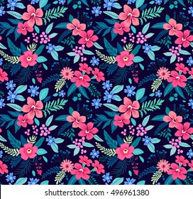 Floral seamless pattern with beautiful pink flowers. Tropical design. Exotic flowers and leaves. Pattern for summer fashion prints. Blooming jungle. Dark blue background. Vector illustration.