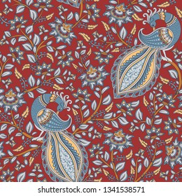 Floral seamless pattern with peacocks on dark red background. Indian style. Kalamkari.