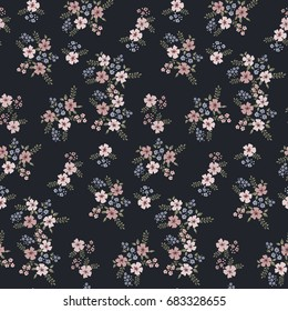 Floral seamless pattern of small flowers in pastel colors on a dark background