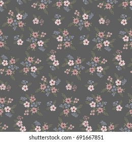Floral seamless pattern of small flowers in pastel colors on a dark grey background