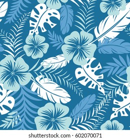 Floral seamless pattern. Tropical flowers and leaves on blue navy background. Vector illustration.
