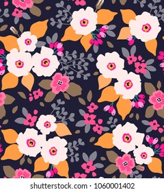 Floral seamless pattern with white flowers in vintage style. Surface design of modern flowers and leaves on a dark blue background. A bouquet of spring flowers for fashion prints. Trendy floral backgr