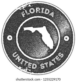 Florida map vintage stamp. Retro style handmade label, badge or element for travel souvenirs. Dark grey rubber stamp with us state map silhouette. Vector illustration.