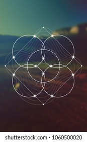 Flower of life interlocking circles and triangles sacred geometry illustration with golden ratio digits in front of photographic background.