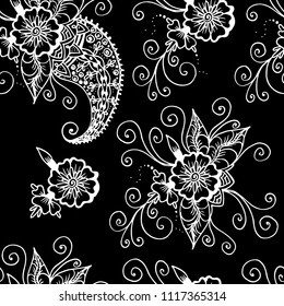 Flowers and paisley. Abstract linear drawing. Seamless pattern. White on a black background. For backgrounds, home textiles, women products