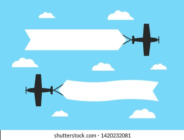 Flying airplanes with advertising banners on blue background. Planes with blank ribbons.