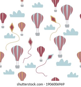 Flying balloons and kites in the sky. The seamless pattern is suitable for children's textiles, cover of notebooks, postcards and any children's design.