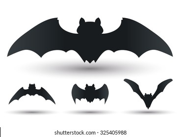 Flying bats silhouettes set in different forms and sizes.