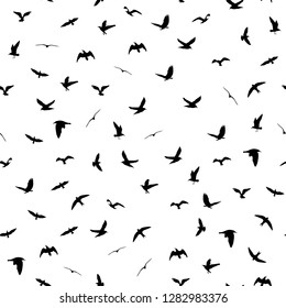 Flying birds silhouettes on white background. Animals seamless detailed pattern. Black on white backgound. Vector illustration