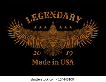 """Flying eagle and slogan: """" Lendary 2019. Made in USA."""" Grunge print for t shirt and tattoo art. Boho chic. Orange illustration on the black background."""
