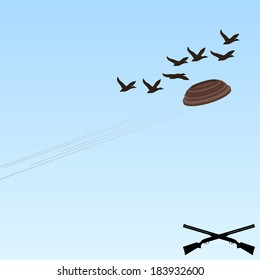 Flying a plate and flying through the sky wild ducks. Trap shooting.