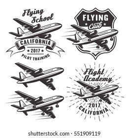 Flying school set of vector emblems, labels and design elements with passenger airplane in monochrome style isolated on white background
