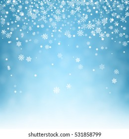 Flying snowflakes on a light blue background. Winter Abstract snowflakes. Falling snow. Vector illustration.