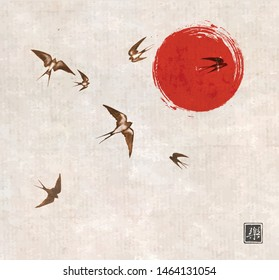 Flying swallow birds and big red sun on vintage background. Traditional Japanese ink wash painting sumi-e. Hieroglyph - joy