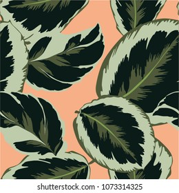 Foliage print pattern with salmon background super tropical!