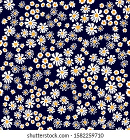 Folkloric pattern with summer daisies and chamomiles. Seamless vector print with small flowers. Summer textile collection.