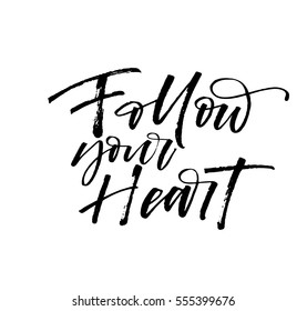 Follow your heart postcard. Phrase for Valentine's day. Ink illustration. Modern brush calligraphy. Isolated on white background.