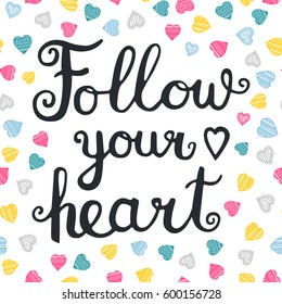 Follow your heart. Vector hand drawn lettering quote for cards, T shirts, labels, posters. Inspirational romantic quote. Isolated. On white background with color doodle hearts.