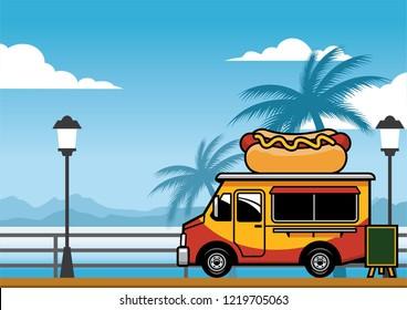 food truck selling hot dog on the beach