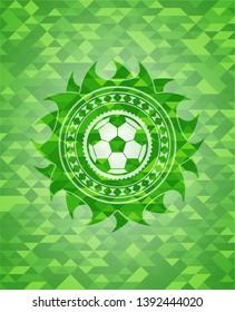 football ball icon inside realistic green mosaic emblem