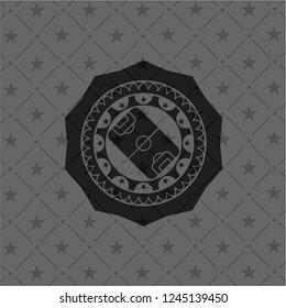 football field icon inside black emblem