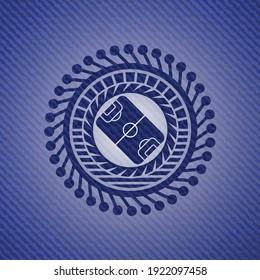 football field icon inside emblem with denim high quality background.