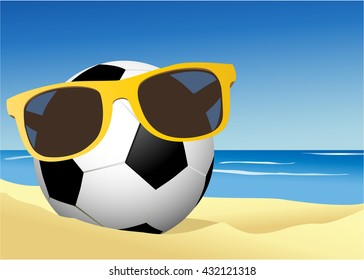 Football on a beach sand