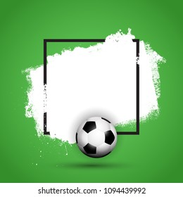 Football / soccer ball on a grunge background with black frame