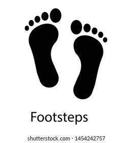 Footprints, footsteps glyph vector icon