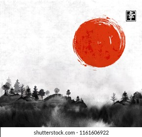 Forest trees in fog and big red sun hand drawn with ink on rice paper background. Traditional oriental ink painting sumi-e, u-sin, go-hua