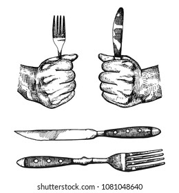 Fork and knife in the hands are compressed. cutlery vector set of sketches