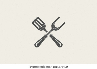 Fork and spatula crossed silhouette as symbol barbecue food preparation hand drawn stamp effect vector illustration. Vintage grunge texture emblem for bbq packaging and menu design or label decoration