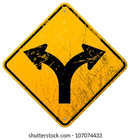 Forked road sign - Damaged yellow metallic roadsign with fork symbol
