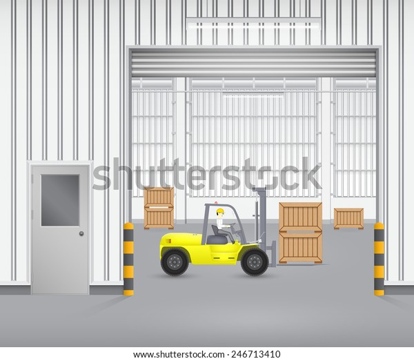 Forklift working with wood crate inside factory.