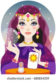 Fortuneteller with crystal ball and tarot card