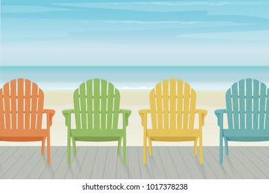 Four colorful wooden Adirondack chairs in a row on a wooden deck at the beach. Beautiful and relaxing sky with wispy clouds.