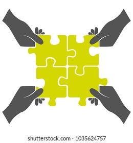Four hands put together puzzle isolated on white background teamwork concept