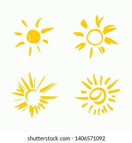 Four painted yellow suns. Vector solar symbols set.