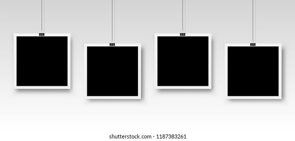 Four photo frames hanging on a clip. Vector illustration