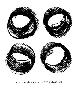 Four round abstract textured black strokes and stamps isolated on a white background
