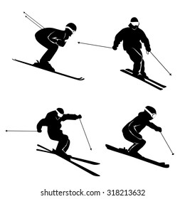 Four silhouettes of skiers