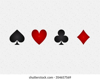 four suits of cards with shadow inside on a white rough paper